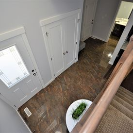 living corridor with brown stone flooring