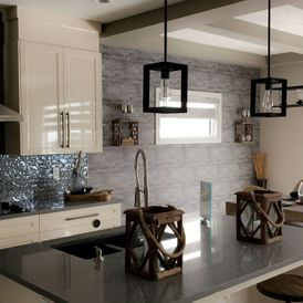 kitchen with brown stone flooring