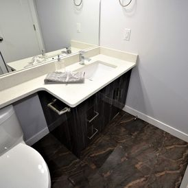 bath room with brown stone flooring