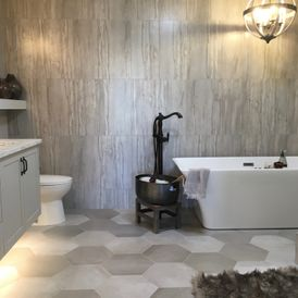 bath room with grey and white stone flooring