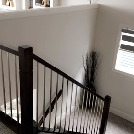 stair case with brown stone flooring