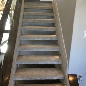 stair case with grey stone flooring