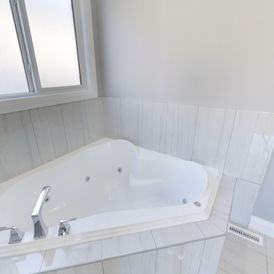 bathroom with white stone flooring