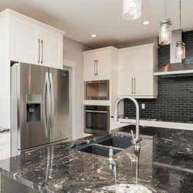 kitchen with black stone flooring