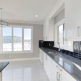 kitchen with white stone flooring