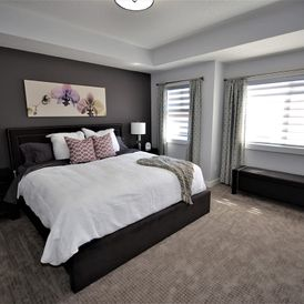 bed room with grey carpet flooring