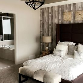 bed room with brown stone flooring
